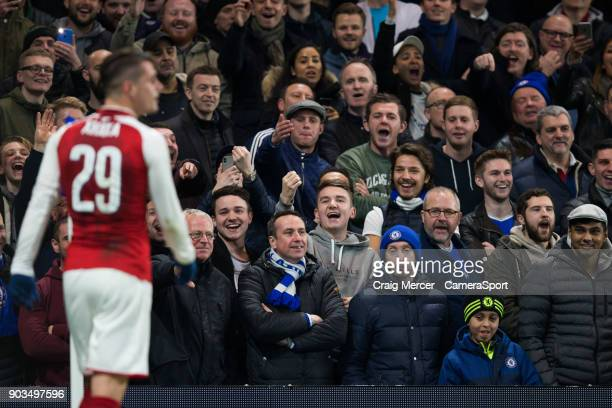 Chelsea fans jeer at Arsenal's Granit Xhaka as he takes a corner during the Carabao Cup SemiFinal First Leg match between Chelsea and Arsenal at...