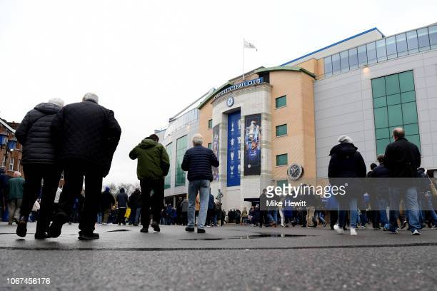 Chelsea fans make their way to the stadium ahead of the Premier League match between Chelsea FC and Fulham FC at Stamford Bridge on December 2 2018...