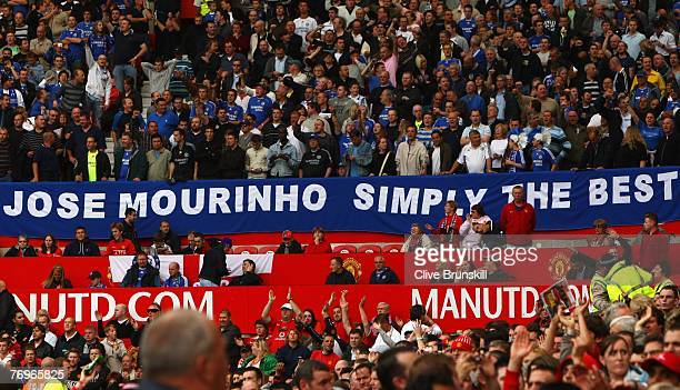 Chelsea fans pay tribute to former manager Jose Mourinho prior to the Barclays Premier League match between Manchester United and Chelsea at Old...