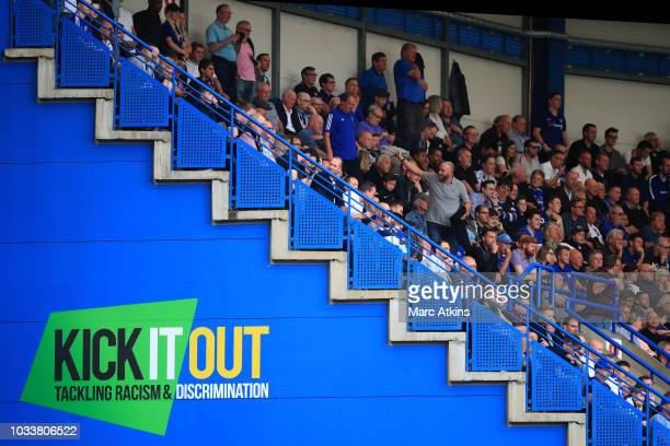 Chelsea fans pictured alongside a Kick it Out slogan during the Premier League match between Chelsea FC and Cardiff City at Stamford Bridge on...