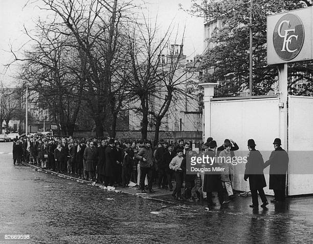Chelsea fans queue for tickets to the FA Cup final replay between Chelsea and Leeds United outside their club's Stamford Bridge ground London 25th...