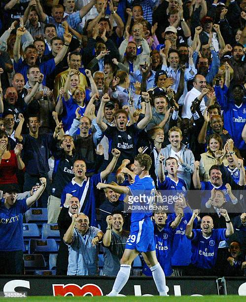 Chelsea fans react as Robert Huth celebrates scoring a goal during the game against MSK Zilina during the UEFA Champions League 3rd qualifying round...