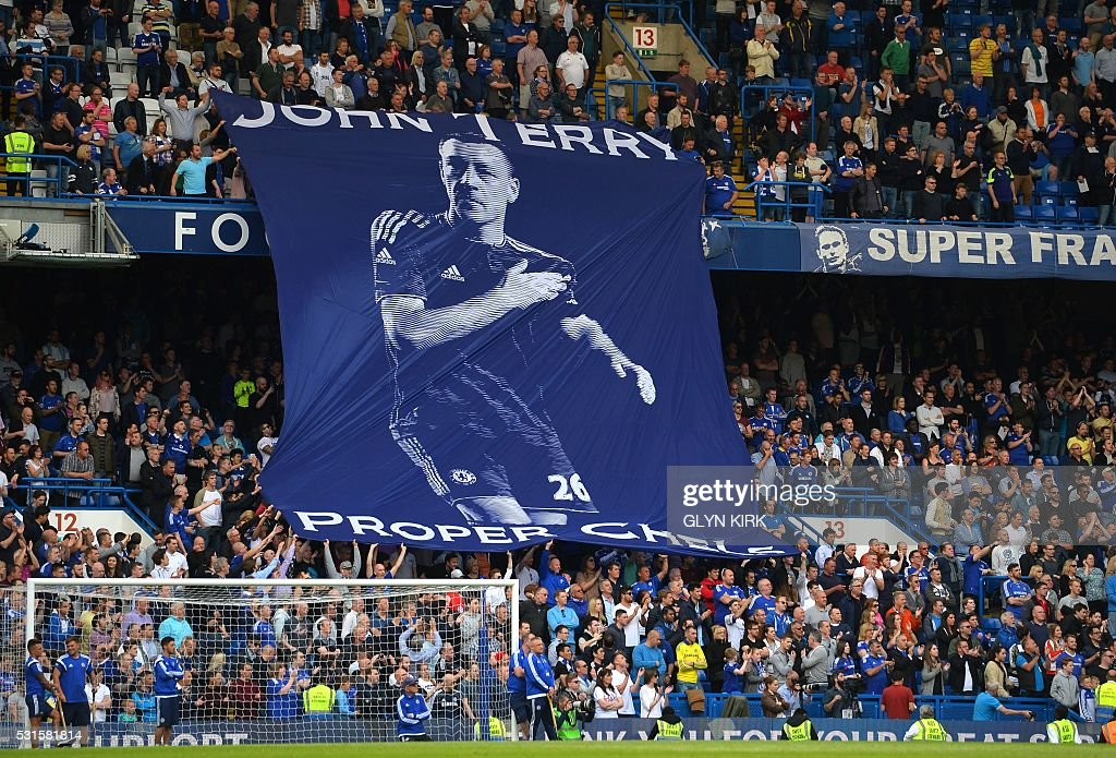 TOPSHOT - Chelsea fans unfurl a banner in support of Chelsea's English defender John Terry after the English Premier League football match between Chelsea and Leicester City at Stamford Bridge in London on May 15, 2016. / AFP / GLYN KIRK / RESTRICTED TO EDITORIAL USE. No use with unauthorized audio, video, data, fixture lists, club/league logos or 'live' services. Online in-match use limited to 75 images, no video emulation. No use in betting, games or single club/league/player publications. /