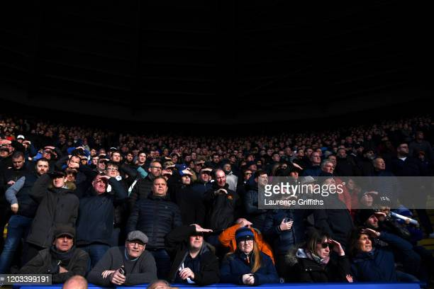 Chelsea fans watch the game from the stands during the Premier League match between Leicester City and Chelsea FC at The King Power Stadium on...