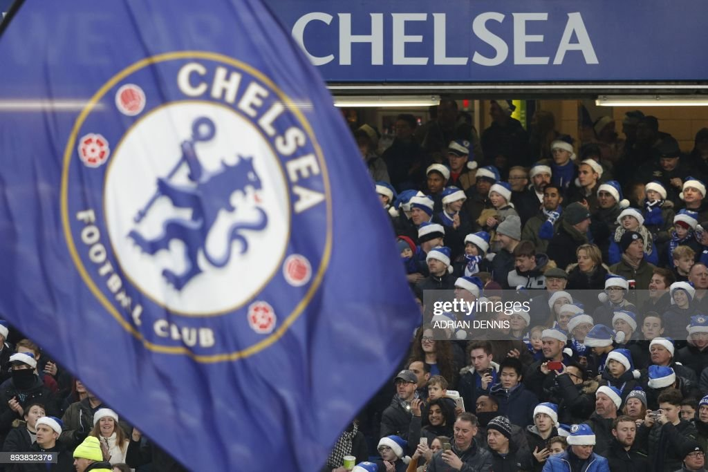 Chelsea fans wear blue santa hats during the English Premier League football match between Chelsea and Southampton at Stamford Bridge in London on December 16, 2017. / AFP PHOTO / Adrian DENNIS / RESTRICTED TO EDITORIAL USE. No use with unauthorized audio, video, data, fixture lists, club/league logos or 'live' services. Online in-match use limited to 75 images, no video emulation. No use in betting, games or single club/league/player publications. /