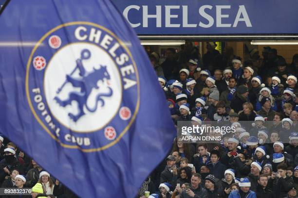 Chelsea fans wear blue santa hats during the English Premier League football match between Chelsea and Southampton at Stamford Bridge in London on...