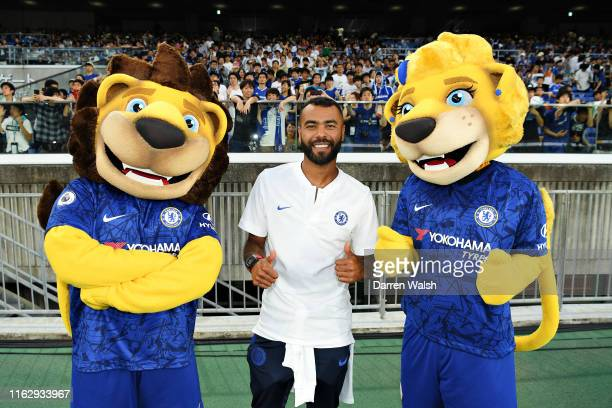 Chelsea FC ambassador Ashley Cole poses for a photo with club mascots Stamford the Lion and Bridget the Lionness before the preseason friendly match...