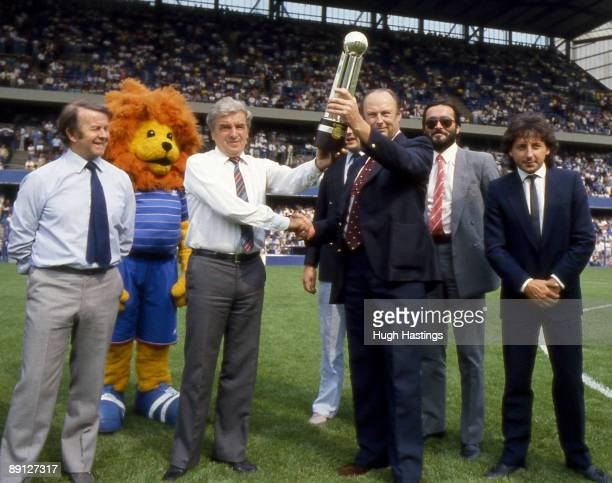 Chelsea FC Manager John Neal accompanied by Assistant Manager Ian McNeill and Chelsea player Mickey Thomas is presented with the 198384 Canon League...