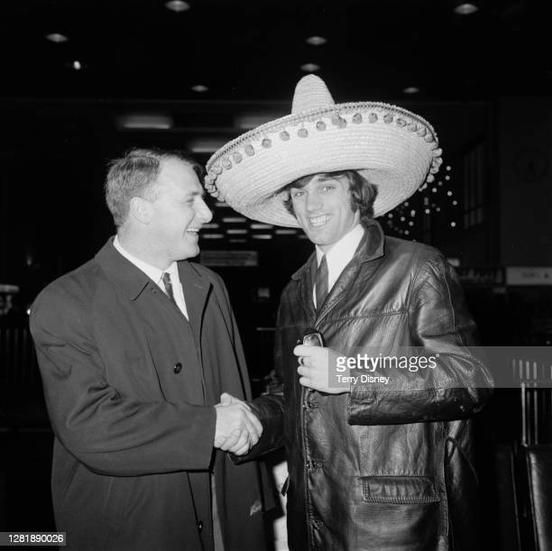 Chelsea FC manager Tommy Docherty greets footballer George Best of Manchester United at London Airport as the latter returns to the UK after a match...