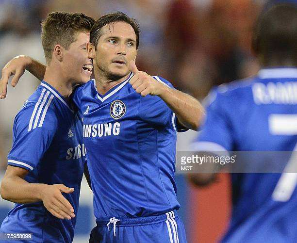 Chelsea FC midfielder Frank Lampard center celebrates with teammates following his goal against AS Roma in the second half of an friendly at RFK...