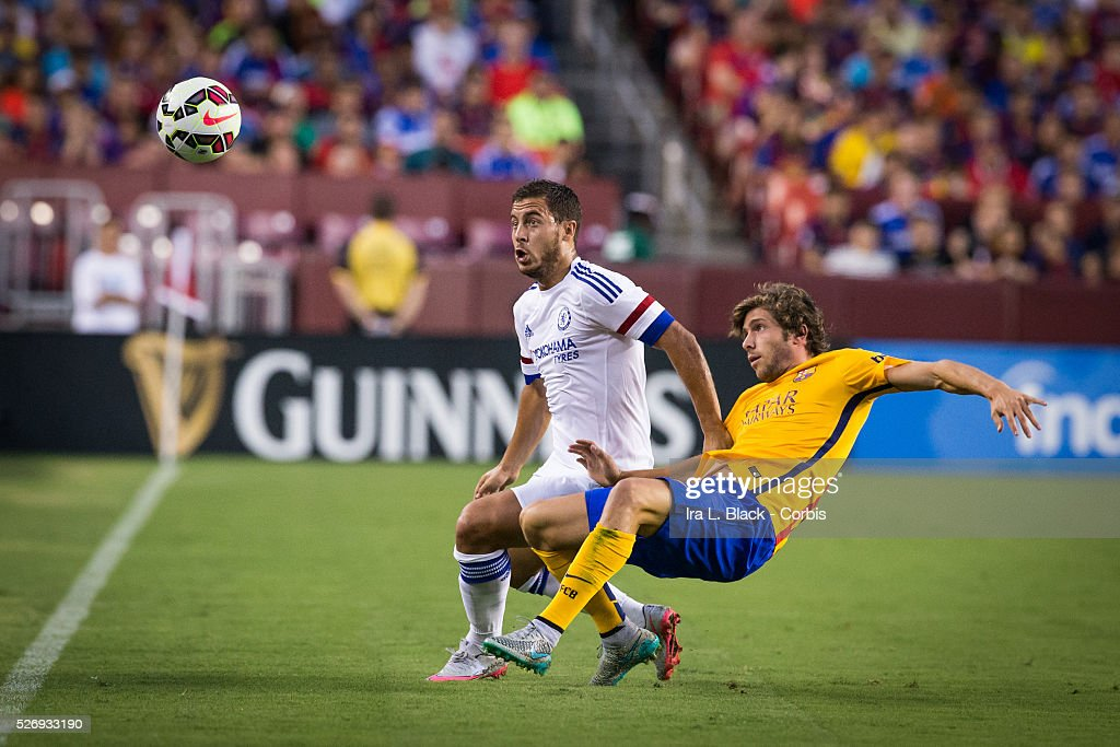 Chelsea FC player Eden Hazard (10) looks for control of the ball against Barcelona FC player Sergi Roberto (20) during the Soccer, 2015 Guinness International Champions Cup Match between Chelsea FC vs Barcelona FC on July 28, 2015 at Fed EX Field in Landover, MD, USA . Chelsea FC and Barcelona FC tied and where Chelsea FC went on to win the match in Penalty Kicks 4 to 2. Photo �� Ira L. Black