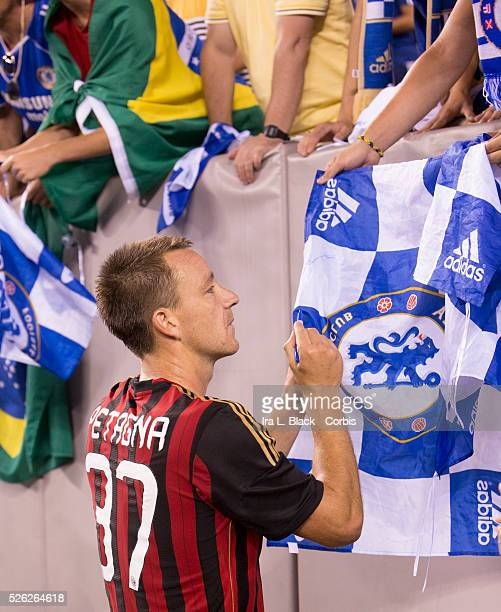 Chelsea FC player John Terry while wearing an the shirt of AC Milan player Andrea Petagna signs autographs after the Guinness International Champions...