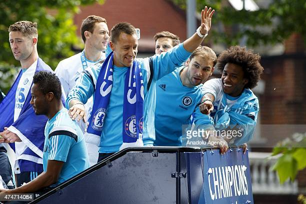 Chelsea FC players celebrate during the open top bus victory parade on May 25 2015 in London England after winning fourth Premier League title in May...