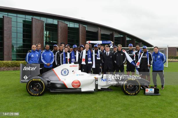 Chelsea FC team pose next to the Sauber F1 car to launch the Chelsea FC and Sauber partnership at the Cobham training ground on May 10, 2012 in...