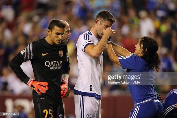 Chelsea firstteam doctor Eva Carneiro attends to Gary Cahill of Chelsea who suffered a bloody nose following scoring the goal which tied the game 22...