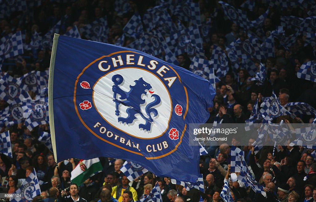 A Chelsea flag is waved during the UEFA Champions League Quarter Final Second Leg match between Chelsea and Liverpool at Stamford Bridge on April 14, 2009 in London, England.