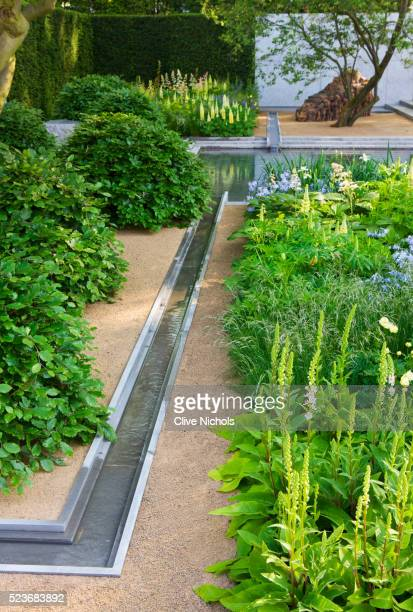 chelsea flower show 2014: laurent perrier garden by luciano giubbilei - metal water rill with pool - chelsea flower show stock pictures, royalty-free photos & images