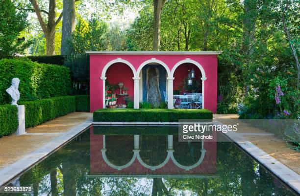 chelsea flower show 2014: the brandalley garden by paul hervey-brookes - formal pond/ pool with statue - chelsea flower show stock pictures, royalty-free photos & images
