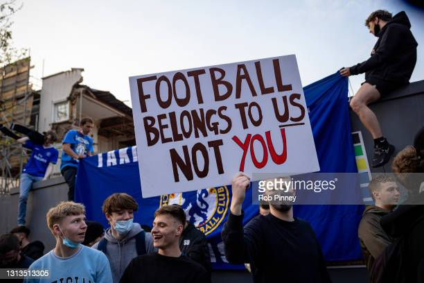 Chelsea Football Club fans celebrate outside the team's Stamford Bridge stadium on April 20, 2021 in London, England, after it was announced that...
