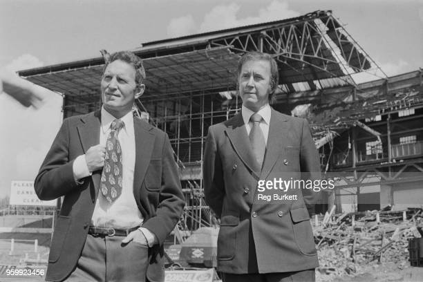 Chelsea Football Club manager Dave Sexton pictured on left with Chairman Brian Mears as they stand on the pitch in front of the partly demolished...