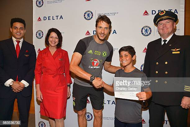 Chelsea Football Club's Carlo Cudicini and Children's Hospital Los Angeles patient Alex Idolor with Delta Air Lines brand ambassadors join Delta Air...