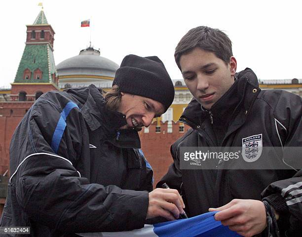 Chelsea football club's Russian player Alexey Smertin signs an autograph for a fan as the team take a sightseeing tour around Red Square in Moscow,...