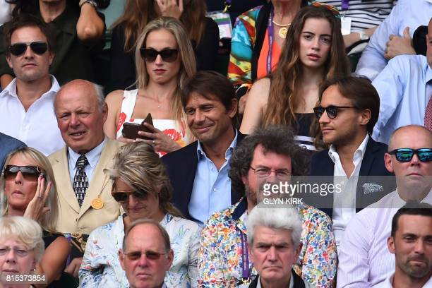 Chelsea football manager Antonio Conte sits in the Royal box on Centre Court for the men's singles final match on the last day of the 2017 Wimbledon...