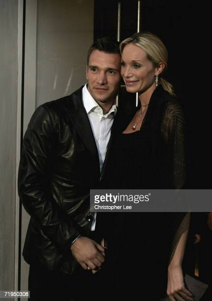 Chelsea football player Andriy Shevchenko and his wife Kristen Pazik pose for the cameras outside the new Armani Casa store as they help celebrate...