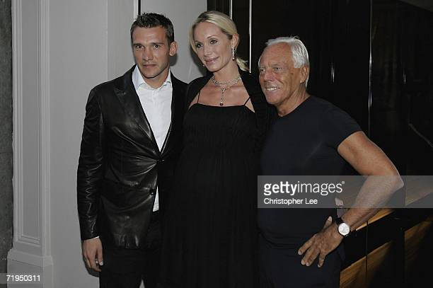 Chelsea football player Andriy Shevchenko and his wife Kristen Pazik with Giorgio Armani pose for cameras outside the new Armani Casa store as they...