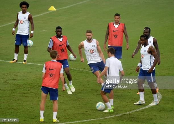 Chelsea football players participate in a training session in Singapore on July 24 ahead of the International Champions Cup football match between...