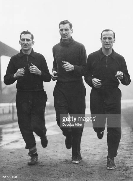 Chelsea football players Stan Wicks Roy Bentley and Ron Greenwood jogging together during training at Stamford Bridge London January 21st 1954