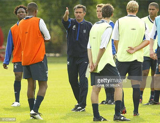 Chelsea Football team's newly appointed Chelsea Football Manager Jose Mourinho talks to his players at the training session at Chelsea Football...