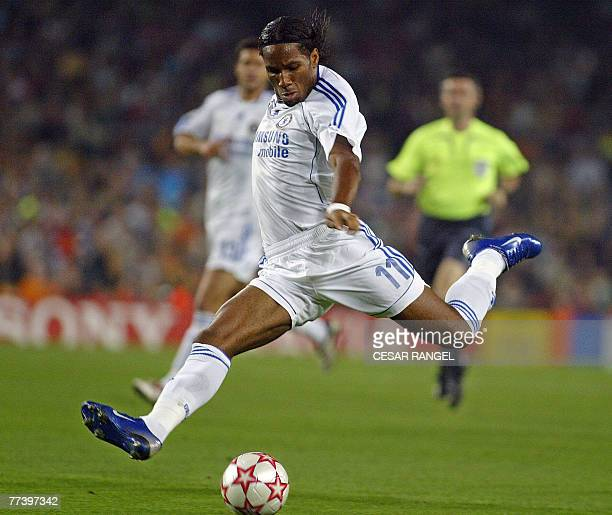 Chelsea footballer Didier Drogba has a shot on goal against Barcelona during a Champions League Group A football match at the Camp Nou stadium in...