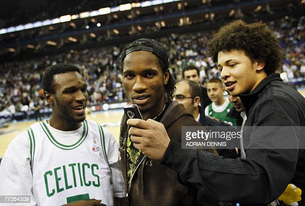 Chelsea footballer Didier Drogba is surrounded by fans at halftime during the basketball game between The Minnesota Timberwolves and the Boston...