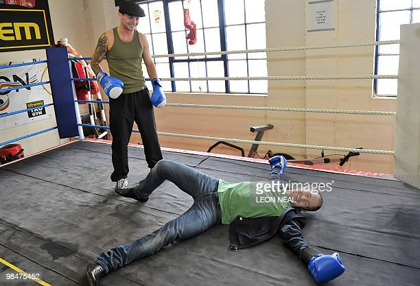 Chelsea footballer Joe Cole poses for pictures with his friend professional boxer Kevin Mitchell during a photocall at the TKO Ultrachem gym in east...