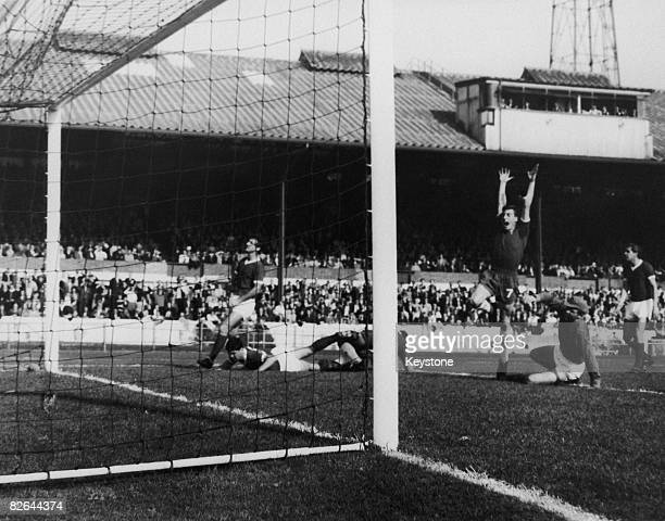 Chelsea footballer Murry celebrates as teammate Bridges scores his team's second goal against Blackburn at Stamford Bridge London 3rd October 1964
