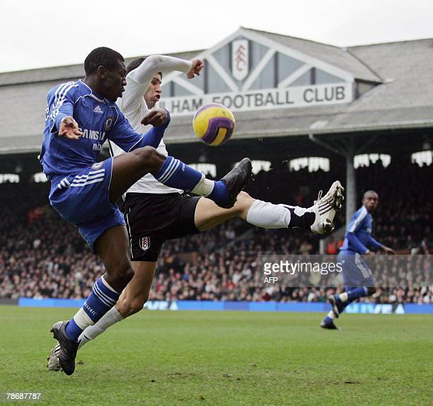 Chelsea footballer Shaun Wright-Phillips is challenged by Fulham footballer Dejan Stefanovic during their Premiership match at Craven Cottage in...
