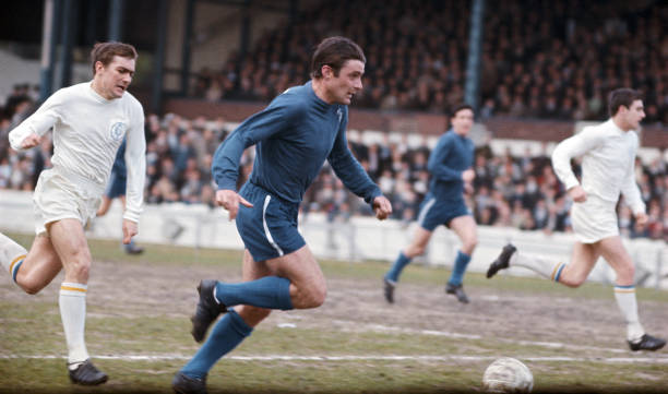 Chelsea forward Bobby Tambling sprints past Terry Cooper during a First Division match against Leeds United at Stamford Bridge on May 6, 1967 in...