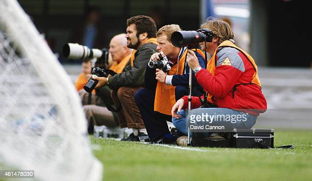 Chelsea forward David Speedie swaps his boots for a camera as he joins the photographers behind the goal for the Canon League Division One match...