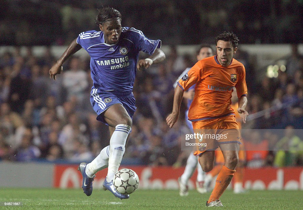 Chelsea forward Didier Drogba on the ball while being chased : News Photo