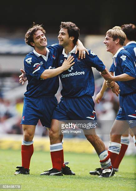 Chelsea forward Gavin Peacock is congratulated by John Spencer after scoring in a Pre Season match at White Hart Lane in London England