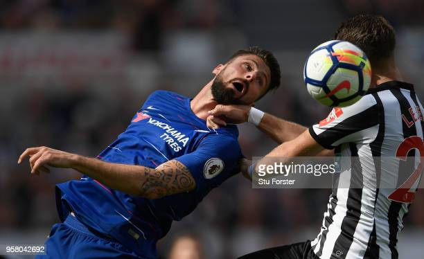 Chelsea forward Olivier Giroud is challenged by Florian Lejeune of Newcastle during the Premier League match between Newcastle United and Chelsea at...