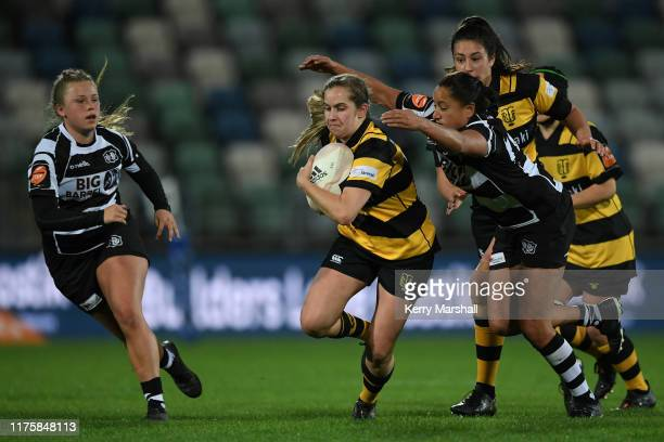 Chelsea Fowler of Taranaki makes a break during the round 4 Farah Palmer Cup match between Hawke's Bay and Taranaki at McLean Park on September 20...