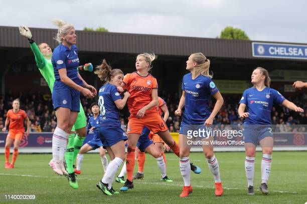 Chelsea goalkeeper AnnKatrin Berger Millie Bright Maren Mjelde and Ada Hergerberg of Lyon go up for the ball during the Women UEFA Champions League...