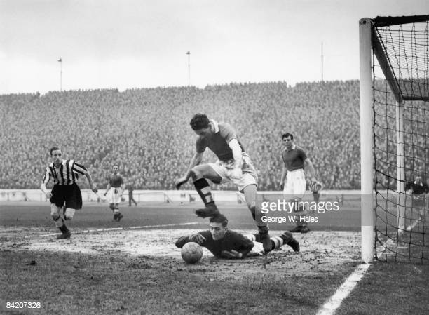 Chelsea goalkeeper Charlie Thomson stops a shot from Hannah during a match between Chelsea and Newcastle at Stamford Bridge London 12th February 1955...