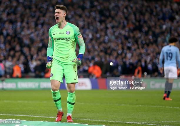Chelsea goalkeeper Kepa Arrizabalaga celebrates after saving Manchester City's Leroy Sane's shot in the penalty shoot out during the Carabao Cup...