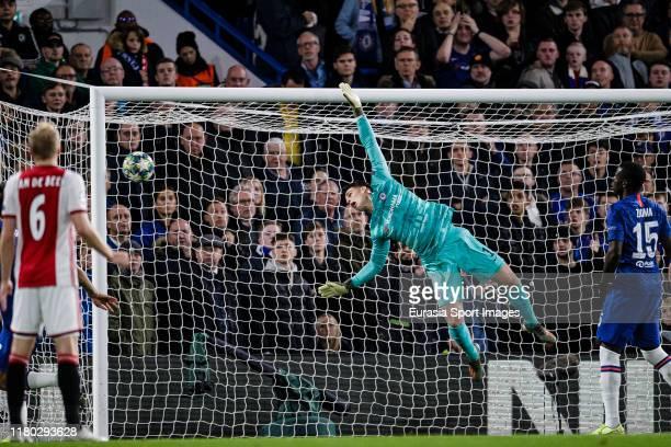 Chelsea Goalkeeper Kepa Arrizabalaga dives despairingly to keep out Hakim Ziyech of Ajax earlier freekick during the UEFA Champions League group H...