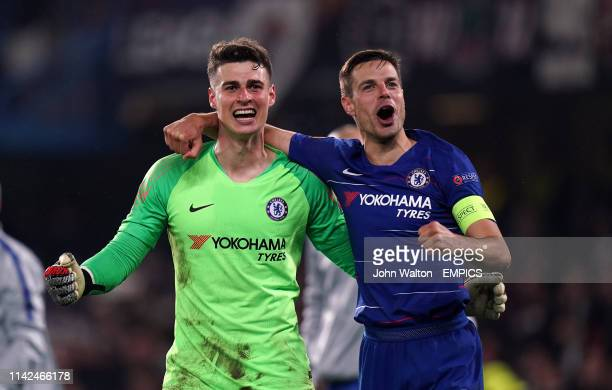 Chelsea goalkeeper Kepa Arrizabalaga is mobbed by his teammate Cesar Azpilicueta after they win the penalty shootout Chelsea v Eintracht Frankfurt...