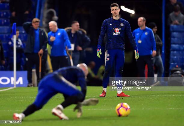 Chelsea goalkeeper Kepa Arrizabalaga looks on at goalkeeper Willy Caballero during the warm up before the Premier League match at Stamford Bridge...