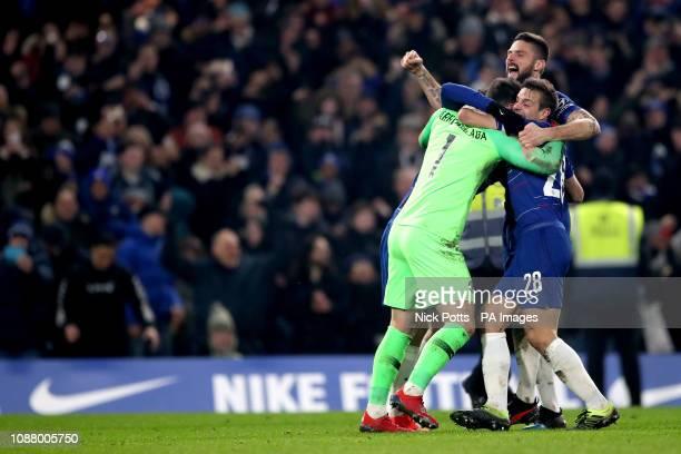 Chelsea goalkeeper Kepa Arrizabalaga Olivier Giroud and Cesar Azpilicueta celebrate after David Luiz scores the winning penalty in the shootout...
